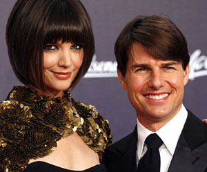 Katie Holmes and Tom Cruise look weird.