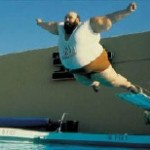 Fat man diving into pool.
